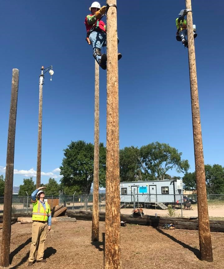 David Swisher overseeing the training of Comcast field technicians on telephone poles.